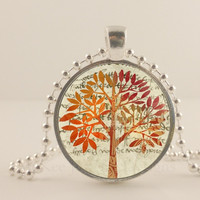 """Tan, brown and Peach tree, 1"""" round glass and metal Pendant necklace Jewelry."""