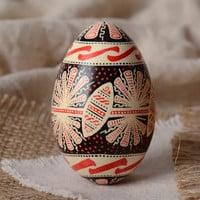 Handmade traditional painted goose egg with rich ornament Easter decoration