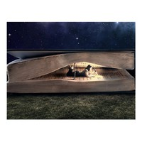 Woman Reading Inside Book at Night Postcard