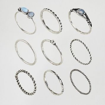 ASOS CURVE Pack of 9 Moon Stone Twist Rings at asos.com