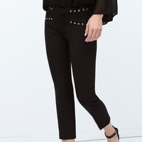 Skinny trousers with eyelets