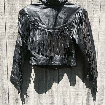 vintage 80s biker babe cropped black leather motorcycle jacket / leather fringe along back and arms / medium