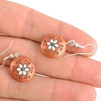 Small handmade round brown ceramic dangling earrings in boho chic style