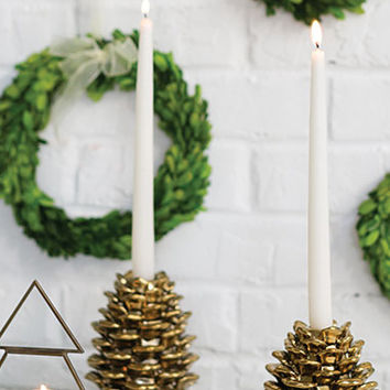 Gold pine cone candle holder