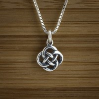 Tiny Celtic Knot Charm STERLING SILVER by LittleDevilDesigns