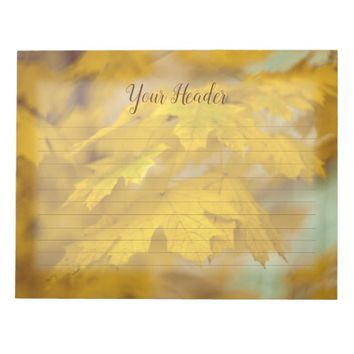 Yellow autumn maple leaves. Lined. Notepad