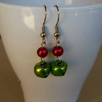 Green jingle bell christmas earrings with red pearl.