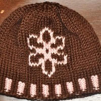 Knit baby hat in pink and brown with flower detail