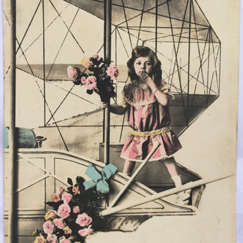 Photomontage of little girl standing on an airplane * Tinted Photograph Child riding a plane * Antique French Postcard early 1900s