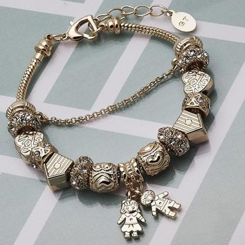 Gold Layered Women Little Boy Charm Bracelet, with White Crystal, by Folks Jewelry