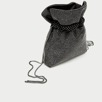 SHINY REVERSIBLE MINI BUCKET BAG DETAILS