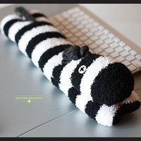 A silly zebra keyboard wrist rest with exclusive cross button eyes, 16 inches long