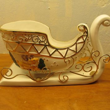 vintage porcelain and metal sleigh holiday decoration