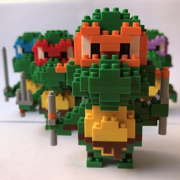 Ninja Turtle Toy Charmander Bulbasaur Squirtle Eevee Child Anime Building Blocks Brinquedos Toys for Children    W0148