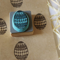 Egg with pattern design. Easter hand carved rubber stamp for decoration.