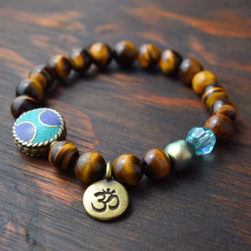 Women's Beaded Bracelet. Tiger Eye Bracelet. OM Charm Bracelet. Women's Yoga Bracelet. Tibetan Bead Bracelet. Lotus and Lava Bracelet.