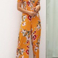 A| Chicoth Off Shoulder Holiday Floral Shirred Jumpsuit