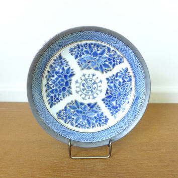 Blue pewter clad porcelain bowl hand decorated in Hong Kong