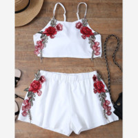 White pair of embroidery embroidery flower pants two sets