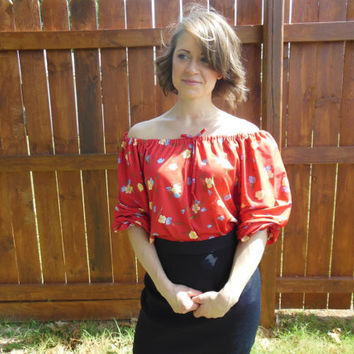 Vintage 1970's peasant blouse with elastic neckline.  Red with blue and yellow flowers.  Hippie//boho//gypsy//peasant