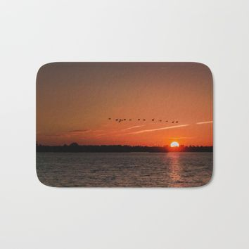 Flight Over the Sun Bath Mat by Scott Hervieux