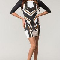 Black, White, and Gold Form Fitting Dress with V-Cut Back