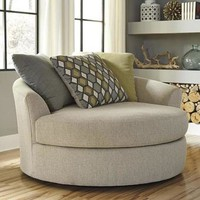 Casheral Oversized Swivel Accent Chair in Linen | Nebraska Furniture Mart