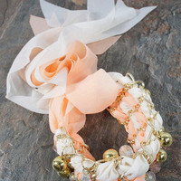 """tie up the loose ends"" bracelet in taupe and peach - three bird nest"