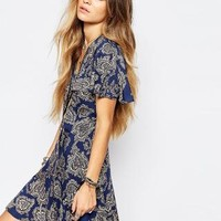 Reclaimed Vintage | Reclaimed Vintage Button Front Mini Tea Dress With Ruffle Detail In Paisley Print at ASOS