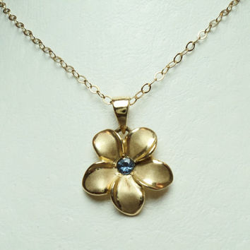 Yogo Sapphire Flower Pendant has .08 carat Yogo Sapphire set in 14KT Yellow Gold. YP 53