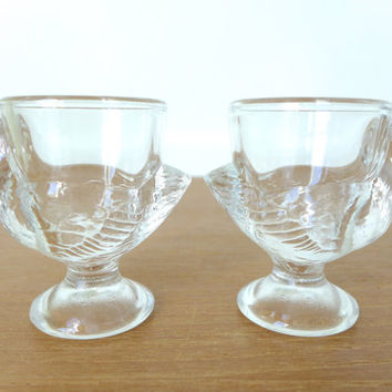 Four pressed glass chicken egg cups made in France