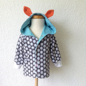 Cool reversible baby hoodie with ears. Dark gray knit with stars and white knit with blue stripes. Size: 12 - 18 months. Ready to ship