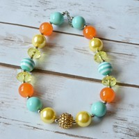 Chunky beaded necklaces for little girl and toddler outfits. Perfect for photo sessions.Glitter gold, orange, yellow and aqua beads. Your Final Touch
