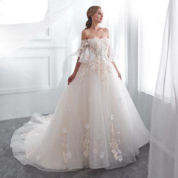 Wedding Dresses Champagne Ball Gown Off Shoulder Short Sleeves Lace Applique Bride Gowns