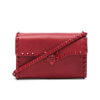 Valentino Medium Rockstud Shoulder Bag in Red & Red | FWRD
