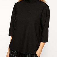ASOS Top With Clean High Neck And 3/4 Length Sleeves at asos.com