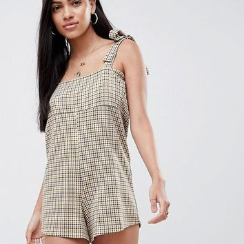 ASOS DESIGN playsuit in check with tie straps at asos.com