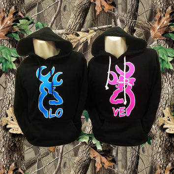 Two Black Deer Hoodies That Read Love.