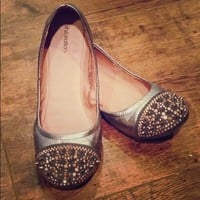 Gray spiked flats with pink studs