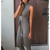 Dark olive drab jumpsuit with criss cross open back detail | Indie | escloset.com