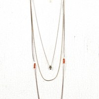 skull charm triple chain necklace