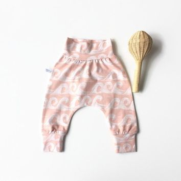 Baby harem pants with waves. Dusty pink pants with same fabric waistband and cuffs. Comfortable toddler pants. Jersey knit fabric.
