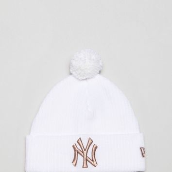 New Era Ribbed Beanie with Rose Gold NY Embroidery at asos.com