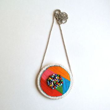 Embroidered pendant necklace geometric round shape with bright colors pink, orange, blue, green, red with multicolored African glass beads 1