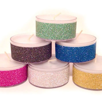 "Sparkle tea light candles in a variety of colors- blue, pink, black, silver, green, or gold - 12 count .75"" tall unscented glitter candles"