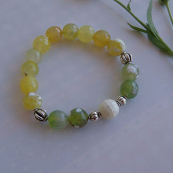 Green and Yellow Agate Crack Faceted Stretch Beaded Bracelet with Silver Plated Beads and Milky Opal Bead as a Central Motif.