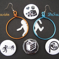 Portal Earrings and four botton pin badges