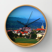Village skyline on a summer afternoon Wall Clock by Patrick Jobst