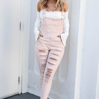 Serving It Dust Pink Distressed Skinny Leg Overalls
