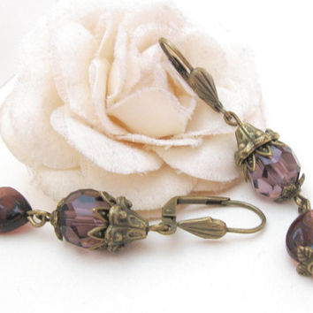 Purple berry earrings with glass beads and brass adornments